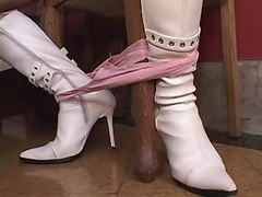 Tgirl in white boots does BJ to guy