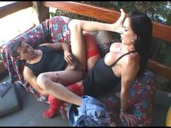 Stockinged shemale spreading guy's cheeks with her mighty cock on the sofa